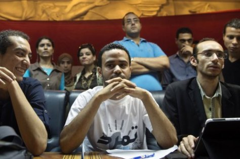 Mahmoud Badr (center), founder of the opposition Tamarod campaign, attends a press conference in Cairo on June 29, 2013. (Khaled Desouki/AFP/Getty)